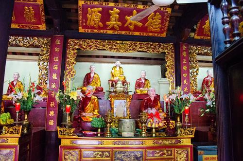 Buddha statues inside Tran Quoc Pagoda Hanoi culture tours