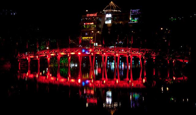 The Huc Bridge sparkling at night - Hanoi city tour