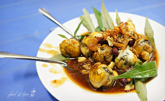 Quail egg fried with tamarind - Southern dishes in Hanoi cuisine tour