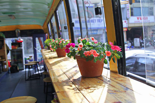 Beautiful flowers inside the bus cafe Hanoi - Things to do in Hanoi