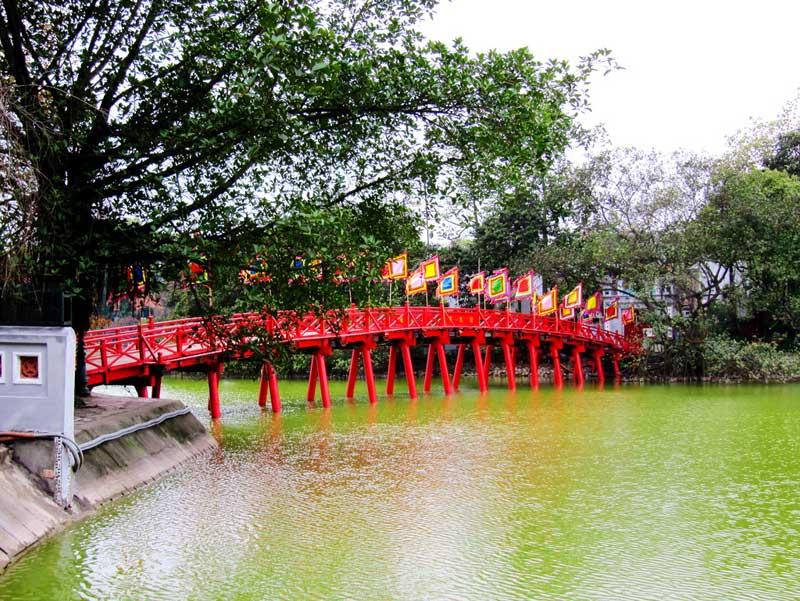 Beautiful The Huc Bridge across Hoan Kiem Lake - city tours in Hanoi
