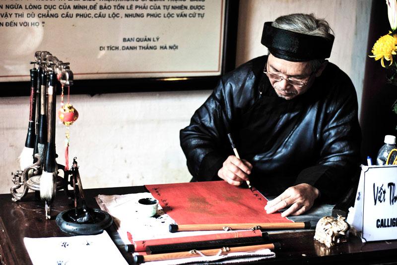 The calligrapher at Ngoc Son Temple - Hanoi city tour