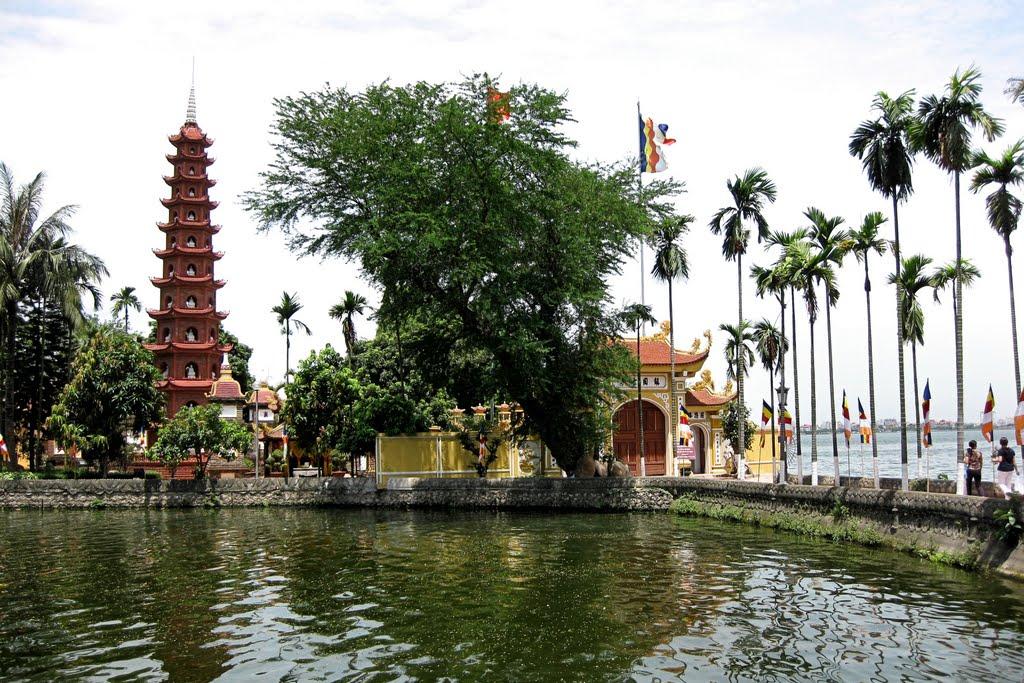 Tran Quoc Pagoda lies nearby the West Lake - Hanoi city tour