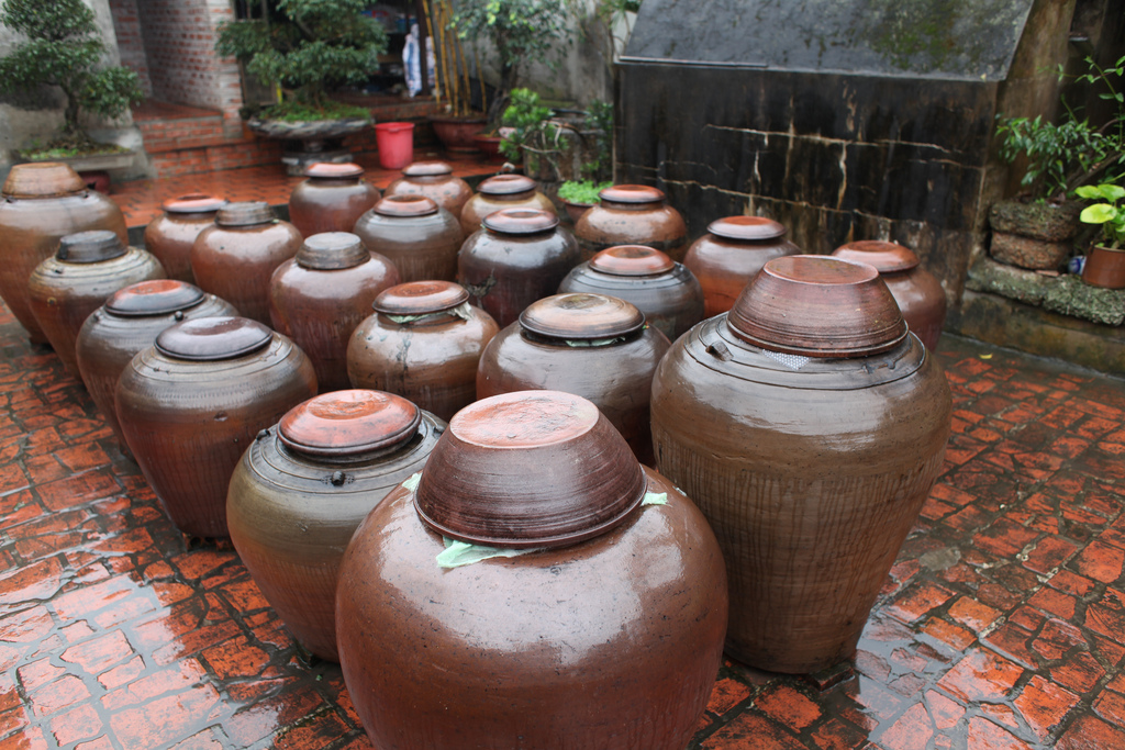 Jars of soya sauce at the garden yard in Duong Lam - Day trip from Hanoi capital