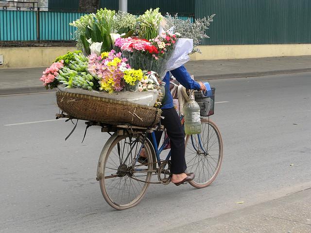 Flower bikes - special feature of Hanoi - Hanoi culture tours