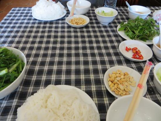 Preparing for a party with la vong grilled fish pies - Hanoi food tours